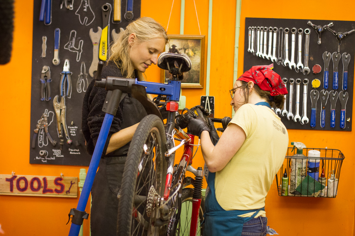 Karen working on a bike with a Beryl's Night participant